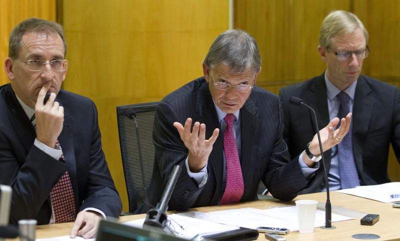 New Zealand Reserve Bank Governor Graeme Wheeler, center, comments as assistant governor John McDermott, left, and deputy governor Grant Spencer attend a press briefing after announcing its raising its benchmark interest rate by quarter of a percentage point to 2.75 percent in Wellington, New Zealand, Thursday, March 13, 2014. The South Pacific nation of 4.5 million has benefited from booming demand in China for its milk products and the gathering pace of a rebuilding effort in the city of Christchurch following an earthquake there three years ago that destroyed much of the downtown. (AP Photo/New Zealand Herald, Mark Mitchell) NEW ZEALAND OUT, AUSTRALIA OUT
