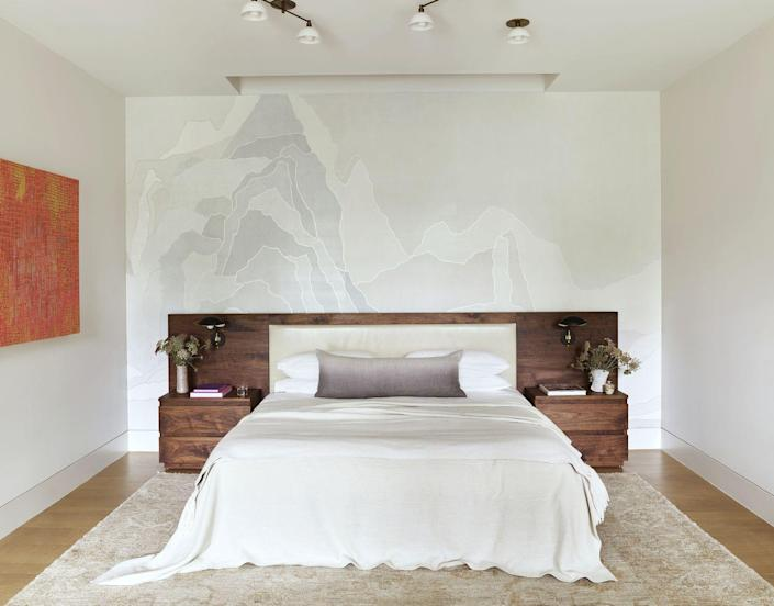 """<p>Committing to a flamboyant wallpaper can be a little intimidating, but there are ways to incorporate pattern on the walls without it feeling overpowering. The shimmering collage wallcovering (<a href=""""https://fromental.co.uk/"""" rel=""""nofollow noopener"""" target=""""_blank"""" data-ylk=""""slk:Fromental"""" class=""""link rapid-noclick-resp"""">Fromental</a>) in this <a href=""""https://www.veranda.com/decorating-ideas/house-tours/a35369884/mcbrearty-dallas-house-tour-march-2021/"""" rel=""""nofollow noopener"""" target=""""_blank"""" data-ylk=""""slk:Meredith McBrearty-designed Dallas bedroom"""" class=""""link rapid-noclick-resp"""">Meredith McBrearty-designed Dallas bedroom</a> creates a point of interest while staying within the neutral palette established in the room. The mixed media painting is by <a href=""""http://andreecarter.com/"""" rel=""""nofollow noopener"""" target=""""_blank"""" data-ylk=""""slk:Andrée B. Carter"""" class=""""link rapid-noclick-resp"""">Andrée B. Carter</a>.</p>"""