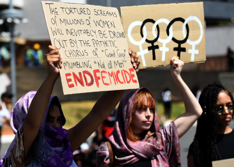 Demonstrators hold up banners as they protest against gender based violence in Sandton, Johannesburg Friday, Sept. 13, 2019. The protesters are calling on President Cyril Ramaphosa to declare a state of emergency, a day after the country's latest crime statistics were released. (AP Photo)