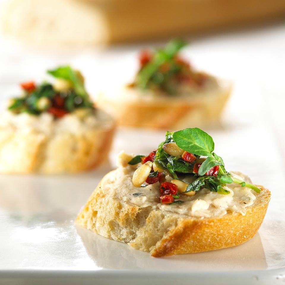 <p>Almost everything for this appetizer can be made ahead--just prepare the white bean and tomato mixture and toast the bread slices. When you're ready, simply assemble the bruschetta, broil and serve!</p>