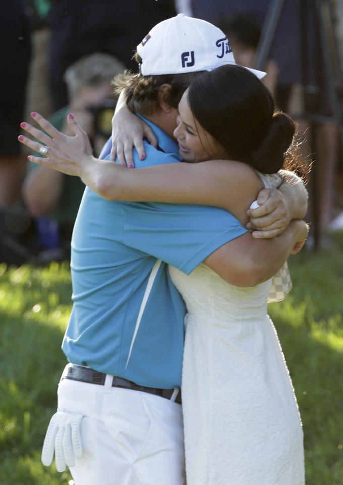 Jason Dufner, left, hugs his wife Amanda after winning the PGA Championship golf tournament at Oak Hill Country Club, Sunday, Aug. 11, 2013, in Pittsford, N.Y. (AP Photo/Julio Cortez)
