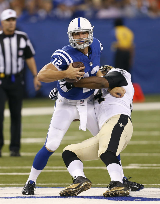 Indianapolis Colts quarterback Andrew Luck, left, is hit by New Orleans Saints defensive end Cameron Jordan during the first half of an NFL preseason football game in Indianapolis, Saturday, Aug. 23, 2014. (AP Photo/Sam Riche)