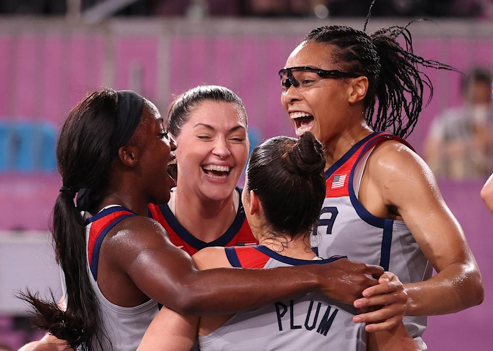 (Left to right) Jacquelyn Young, Stefanie Dolson, Kelsey Plum and Allisha Gray celebrate winning the first 3x3 basketball Olympic gold medal in history. (Photo by Christian Petersen/Getty Images)