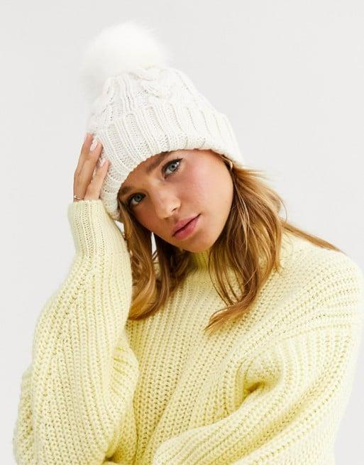 """<p>They can wear the <a href=""""https://www.popsugar.com/buy/New-Look-Cable-Knit-Faux-Fur-Bobble-Hat-517709?p_name=New%20Look%20Cable%20Knit%20Faux%20Fur%20Bobble%20Hat&retailer=asos.com&pid=517709&price=13&evar1=fab%3Aus&evar9=36125225&evar98=https%3A%2F%2Fwww.popsugar.com%2Fphoto-gallery%2F36125225%2Fimage%2F46930060%2FNew-Look-Cable-Knit-Faux-Fur-Bobble-Hat&list1=gifts%2Choliday%2Cwinter%2Cgift%20guide%2Cwinter%20fashion%2Choliday%20fashion%2Cfashion%20gifts%2Cgifts%20for%20women&prop13=api&pdata=1"""" class=""""link rapid-noclick-resp"""" rel=""""nofollow noopener"""" target=""""_blank"""" data-ylk=""""slk:New Look Cable Knit Faux Fur Bobble Hat"""">New Look Cable Knit Faux Fur Bobble Hat</a> ($13) with every Winter outfit this season.</p>"""