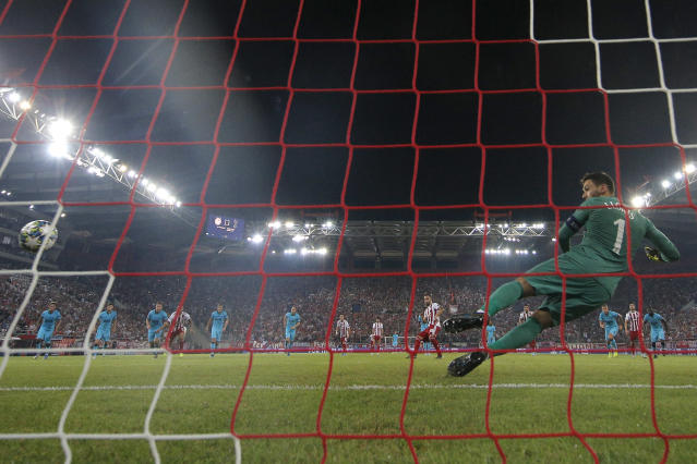 Mathieu Valbuena equalises from the spot for Olympiacos. (Photo by Dean Mouhtaropoulos/Getty Images)