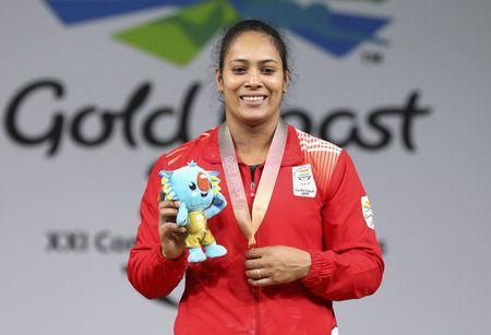 Weightlifting - Gold Coast 2018 Commonwealth Games - Women's 69kg Final - Carrara Sports Arena 1 - Gold Coast, Australia - April 8, 2018. Gold medallist Punam Yadav of India poses with her medal and Borobi plush doll. REUTERS/Athit Perawongmetha