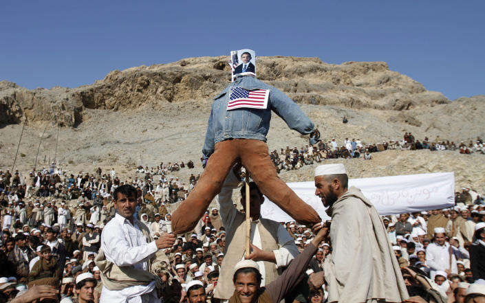 Afghans display an effigy of the US President Barack Obama during anti-US protest over burning of Qurans at a military bass in Afghanistan, in Ghani Khail, east of Kabul Friday, Feb. 24,2012. (AP Photo/Rahmat Gul)