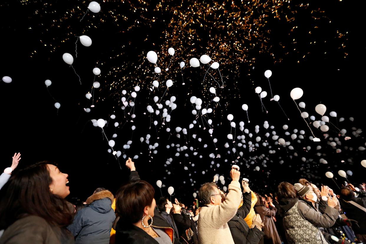 People release balloons as they take part in a New Year's countdown event in Tokyo, Japan on January 1, 2018. (Photo: Toru Hanai / Reuters)
