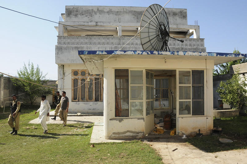FILE - This Nov 18, 2011 file photo shows the guesthouse inside Osama bin Laden's compound in Abbottabad, Pakistan. Bin Laden spent his last weeks in a house divided, amid wives riven by suspicions. On the top floor, sharing his bedroom, was his youngest wife and favorite. The trouble came when his eldest wife showed up and moved into the bedroom on the floor below. Pakistan will deport Osama bin Laden's three widows and their children to Saudi Arabia next week after they finish a 45-day prison sentence for illegally entering and living in the country, their defense lawyer said Friday, April 13, 2012. (AP Photo/Shaukat Qadir, File)