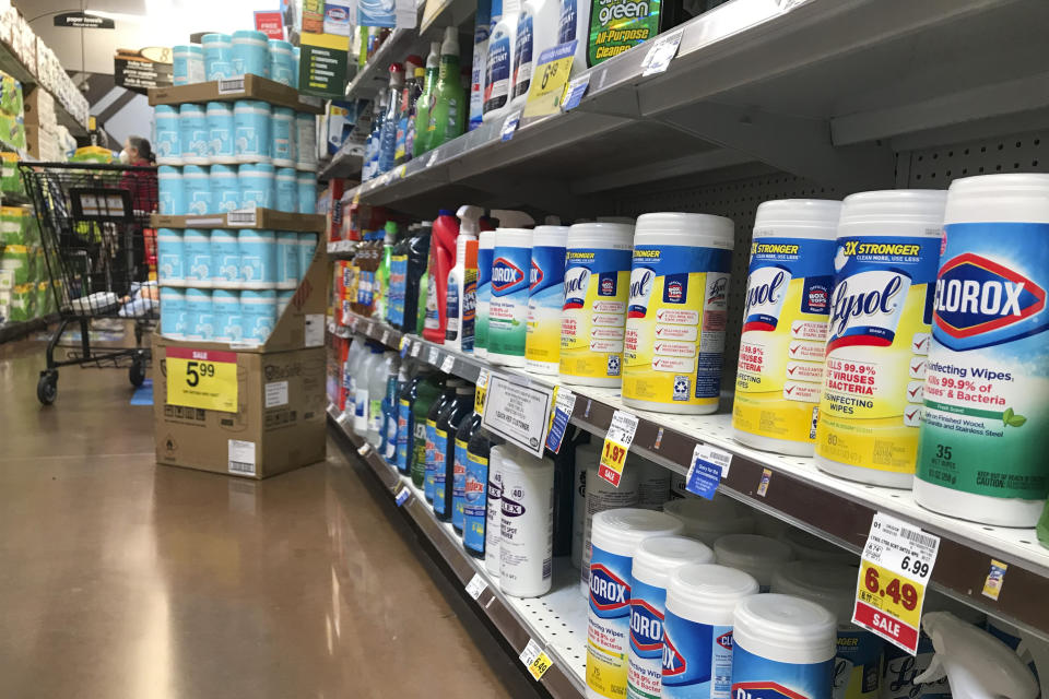 Containers of Lysol and Clorox wipes are on sale at a grocery store on Tuesday, Dec. 1, 2020, in Long Beach, Calif. (AP Photo/Ashley Landis)