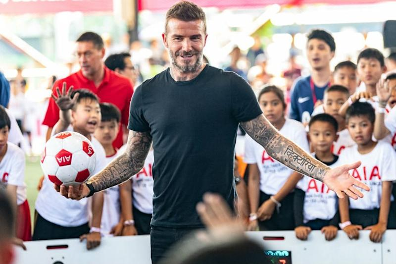 Bend it Like Beckham? How About Bend it 'With' Beckham