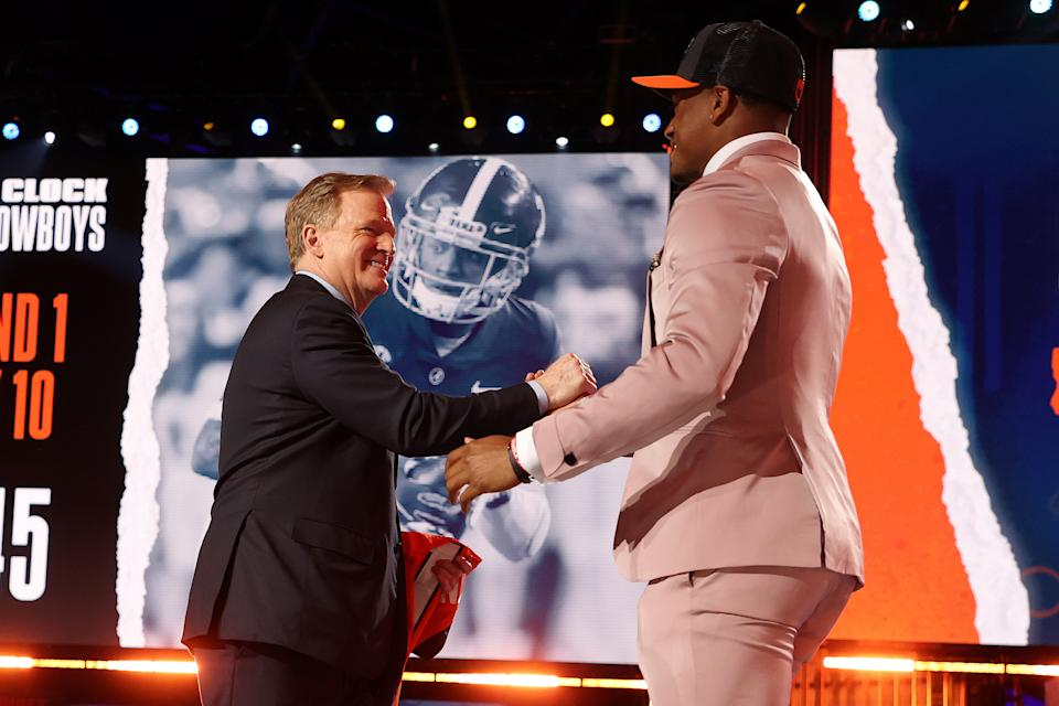 Patrick Surtain II greets NFL Commissioner Roger Goodell onstage after being selected ninth by the Denver Broncos. (Photo by Gregory Shamus/Getty Images)