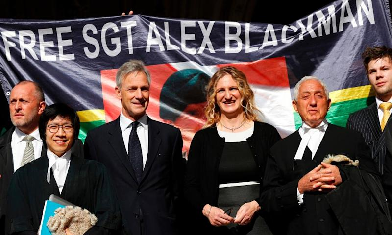 Claire Blackman (centre), wife of Alexander Blackman, whose murder conviction for shooting dead a Taliban prisoner has been quashed, outside the Royal Courts of Justice in London on Wednesday with her legal team.