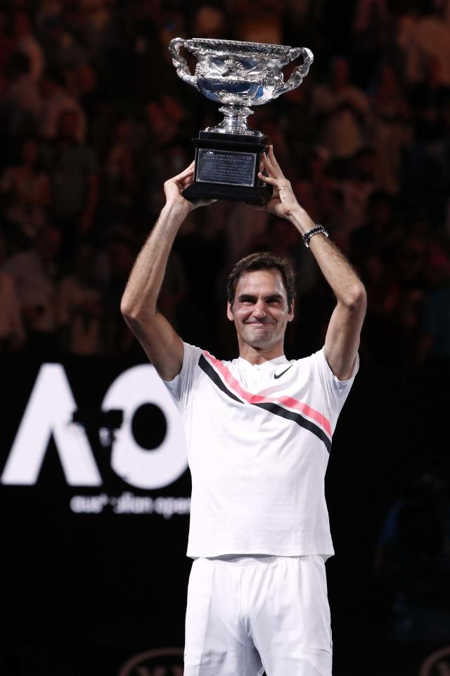 Tennis - Australian Open - Men's singles final - Rod Laver Arena, Melbourne, Australia, January 28, 2018. Switzerland's Roger Federer celebrates with the trophy as he poses after winning the final against Croatia's Marin Cilic. REUTERS/Edgar Su
