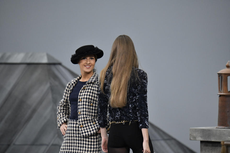 PARIS, FRANCE - OCTOBER 01: Gigi Hadid approaches the woman during the finale and escorted her off the catwalk, because few minutes before a spectator inserted herself among the lineup of models during the finale, identified as Marie Benoliele, best known as Marie S'Infiltre a youtuber, during the Chanel Ready to Wear Spring/Summer 2020 fashion show as part of Paris Fashion Week on October 01, 2019 in Paris, France. (Photo by Victor VIRGILE/Gamma-Rapho via Getty Images)