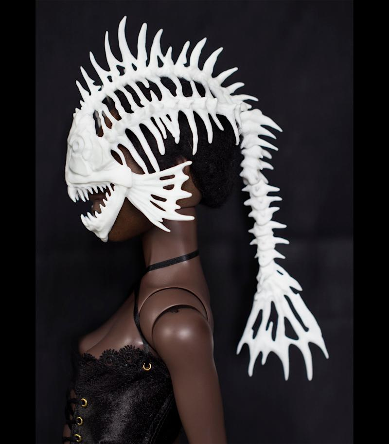 """Hey, your Barbie probably gets bored of looking gorgeous in a plastic way. Allow that doll to express her inner monster with this <a href=""""https://www.shapeways.com/product/VYPE7PFNW/bjd-fish-skeleton-helmet"""" target=""""_blank"""">plastic mask </a>that will surely give Ken a scare."""