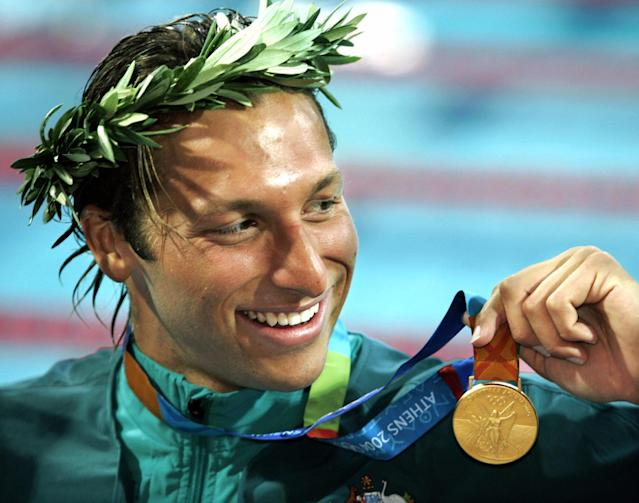 FILE - In this Aug. 16, 2004 file photo, Ian Thorpe of Australia, smiles with his gold medal after winning the 200-meter freestyle at the Olympic Aquatic Centre at the 2004 Olympic Games in Athens. Australian media report the five-time Olympic swimming gold medalist will reveal he is gay in a television interview with English talk show host Michael Parkinson, to be broadcast in Australia on Sunday, July 13, 2014. (AP Photo/Mark J. Terrill, File)