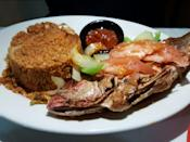 "<p><strong><a href=""https://www.yelp.com/biz/african-grill-and-bar-denver"" rel=""nofollow noopener"" target=""_blank"" data-ylk=""slk:African Grill and Bar,"" class=""link rapid-noclick-resp"">African Grill and Bar,</a> Denver</strong></p><p>""Everything from the fish to the absolutely tantalizing veggie samosas — the lamb, the rice, the service and the amazing chai tea — was just exceptional. The owners were both incredibly friendly and made us feel like we were having dinner at their house."" — Yelp user <a href=""https://www.yelp.com/user_details?userid=62Rh_IflRZOmvlxfgO_WqA"" rel=""nofollow noopener"" target=""_blank"" data-ylk=""slk:Mary V."" class=""link rapid-noclick-resp"">Mary V.</a></p><p>Photo: Yelp/<a href=""https://www.yelp.com/user_details?userid=WRiS2BiHblDHN-9SQlR_BA"" rel=""nofollow noopener"" target=""_blank"" data-ylk=""slk:Ken H."" class=""link rapid-noclick-resp"">Ken H.</a></p>"