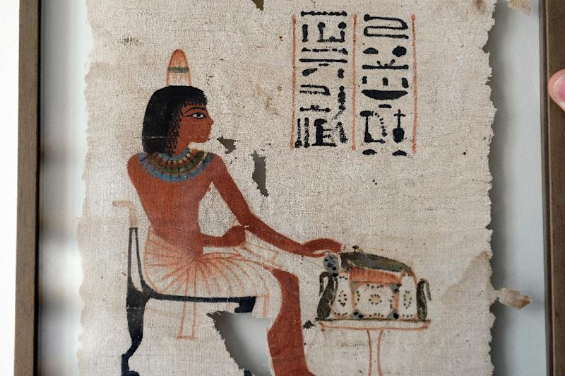 """The funerary shroud of a man called """"Ta-Nedjem"""", dating from the Eighteenth Dynasty of Egypt (1400-1300 BC), is pictured in Paris on June 1, 2015 ahead of its auction on June 18 (AFP Photo/Bertrand Guay)"""