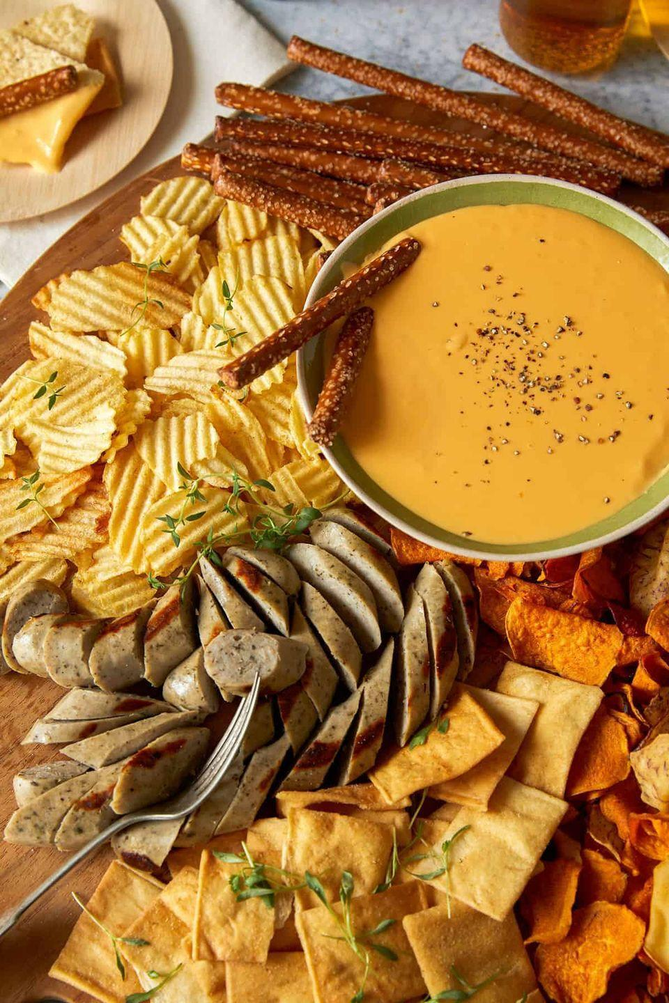 """<p>The combination of velvety cheese, tangy mustard, and your favorite beer is perfect for serving at any event. Try a variety of accompaniments like potato chips, pretzel rods, or even grilled bratwursts. </p><p><strong>Get the recipe at <a href=""""https://www.spoonforkbacon.com/crock-pot-beer-cheese-dip/"""" rel=""""nofollow noopener"""" target=""""_blank"""" data-ylk=""""slk:Spoon Fork Bacon"""" class=""""link rapid-noclick-resp"""">Spoon Fork Bacon</a>.</strong></p>"""