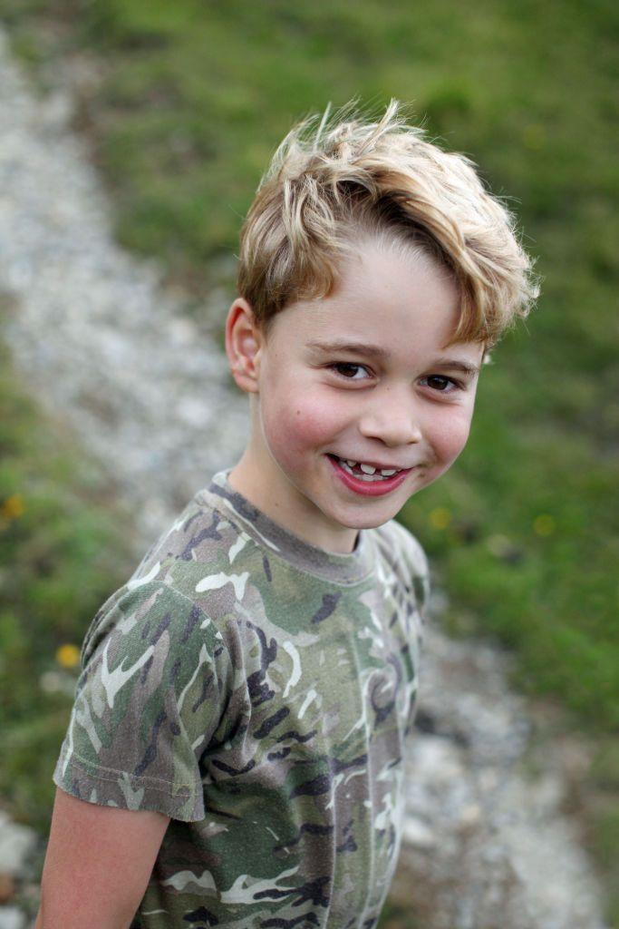 <p>One of the portraits sees the eldest Cambridge child wearing a camouflage pattern T-shirt as he smiles at the camera. </p><p>The top is a sweet tribute to his extended family who have a long history of service in the armed forces.</p>
