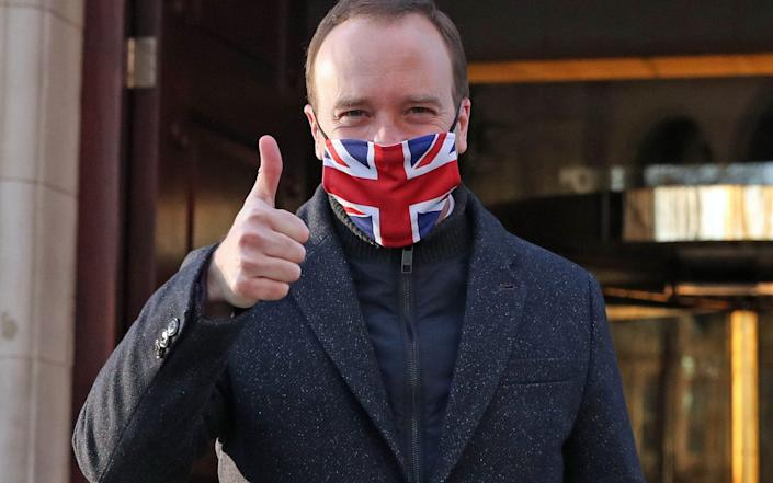 Heath Secretary Matt Hancock gives a thumbs up after the news that a Covid-19 vaccine from Oxford University and AstraZeneca has been approved for use in the UK, paving the way for a mass rollout - Steve Parsons/PA Wire