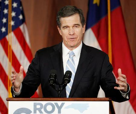 North Carolina Governor-elect Roy Cooper speaks to supporters at a victory rally in Raleigh