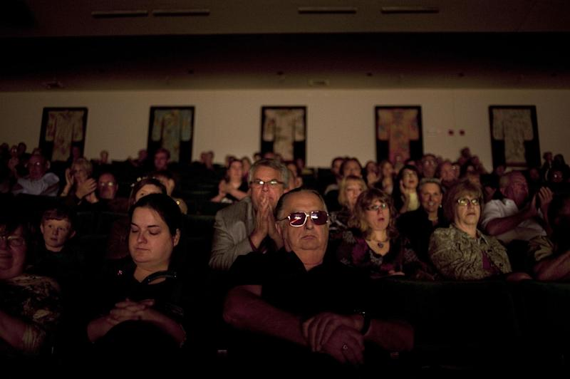 "Patrons of Andy Williams' memorial service watch friends and family of Williams speak at the Moon River Theater, in Branson, Mo.,Sunday, Oct. 21, 2012. Williams, known for singing ""Moon River"" and his Christmas television specials, passed away Sept. 25. (AP Photo/Grant Hindsley)"