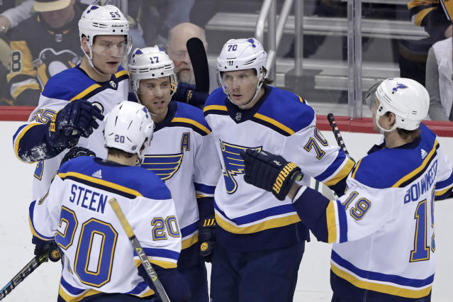 St. Louis Blues' Oskar Sundqvist (70) celebrates with teammates after scoring a goal in the first period of an NHL hockey game against the Pittsburgh Penguins in Pittsburgh, Saturday, March 16, 2019. (AP Photo/Gene J. Puskar)