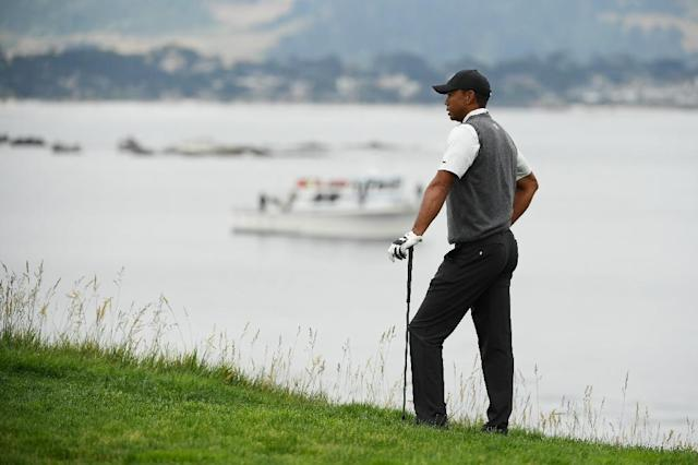 Tiger Woods reacts to a shot during the first round of the 2019 US Open at Pebble Beach (AFP Photo/ROSS KINNAIRD)