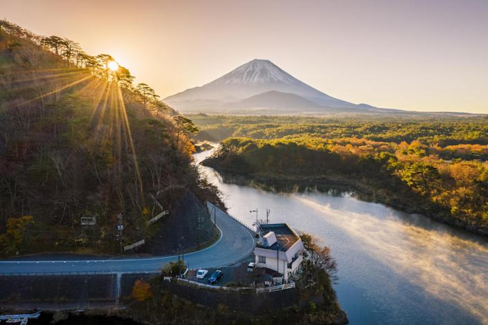 A view of Mount Fuji in the autumn at sunrise.