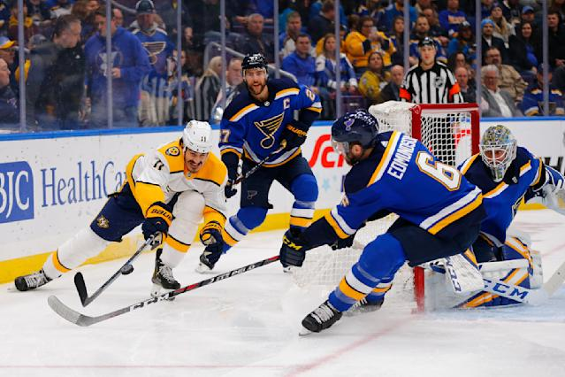Nashville Predators' Brian Boyle (11) looks to beat St. Louis Blues' Joel Edmundson (6) and Alex Pietrangelo (27) to a loose puck during the first period of an NHL hockey game Tuesday, Feb. 26, 2019, in St. Louis. (AP Photo/Dilip Vishwanat)