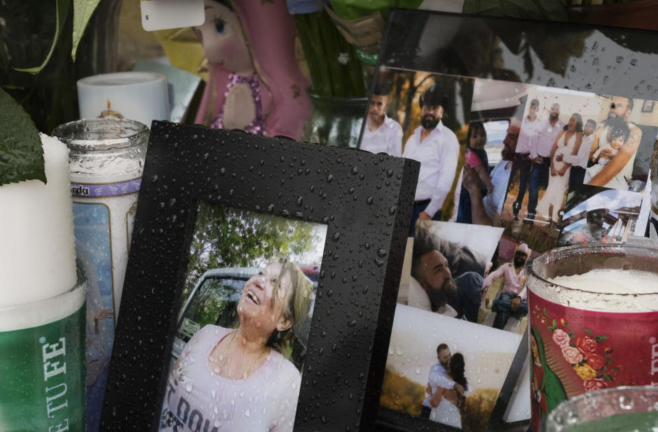 A photo of Joana Cruz, foreground, is seen at a makeshift memorial, Tuesday, May 11, 2021, in Colorado Springs, Colo. Cruz was the matriarch of the family in which six were shot to death early Mother's Day morning. Authorities say the man who fatally shot six people at a birthday party before killing himself was upset after not being invited to the weekend gathering thrown by his girlfriend's family. (Jerilee Bennett/The Gazette via AP)