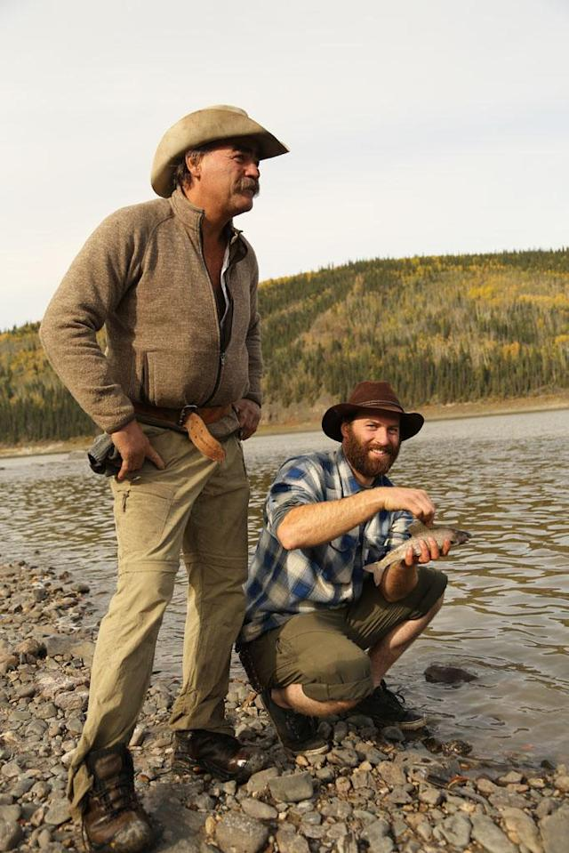 Yukon River, Alaska, USA: Marty Raney & Matt Raney catch fish at the river's edge.