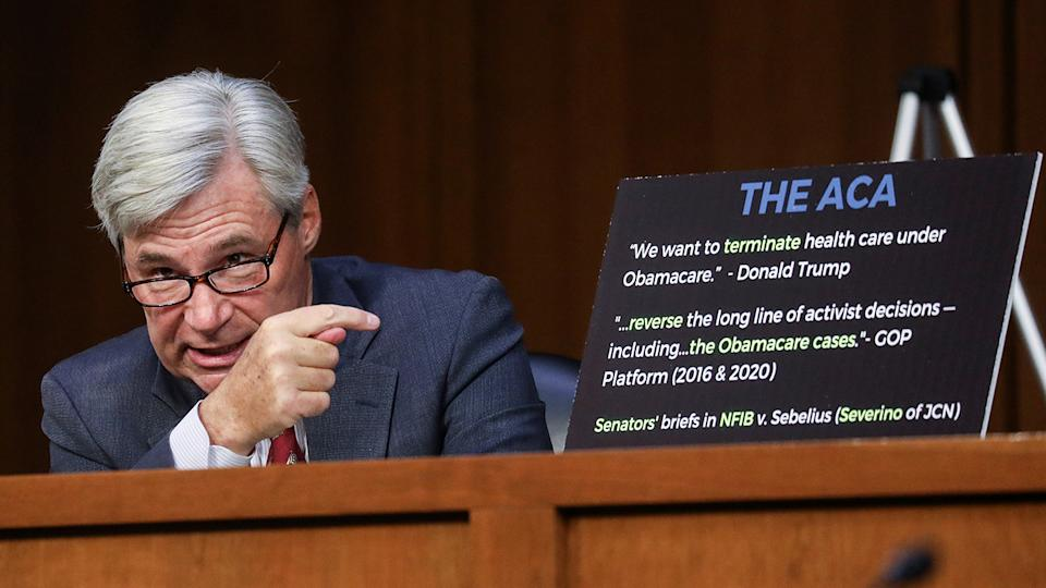 U.S. Senator Sheldon Whitehouse (D-RI) points to a chart as he speaks about efforts by conservatives who oppose the Affordable Care Act during the second day of Senate Judiciary Committee confirmation hearings for Supreme Court nominee Judge Amy Coney Barrett on Capitol Hill in Washington, U.S., October 13, 2020. (Leah Millis/Pool via Reuters)