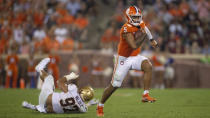 Clemson quarterback D.J. Uiagalelei (5) avoids the tackle by Boston College defensive end Marcus Valdez (97) during the second half of an NCAA college football game against Boston College Saturday, Oct. 2, 2021, in Clemson, S.C. (AP Photo/Hakim Wright Sr.)