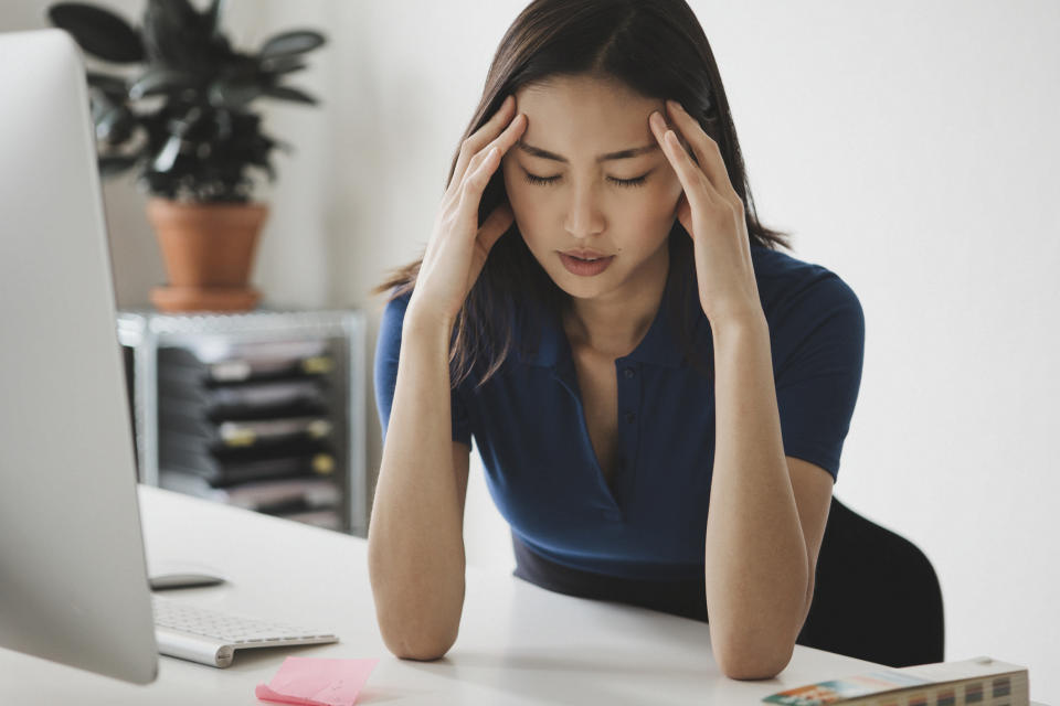 Blue light is emitted from digital screens like computers and phones. Excessive blue light exposure is linked to eye strain, fatigue and headaches. (Photo: Getty Images)