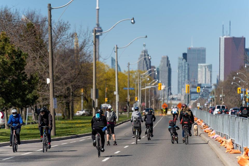 """<span class=""""caption"""">Cyclists ride along Lake Shore Boulevard East as road closures come into effect for the return of the ActiveTO program in Toronto in May, 2021.</span> <span class=""""attribution""""><span class=""""source"""">THE CANADIAN PRESS/Yader Guzman </span></span>"""