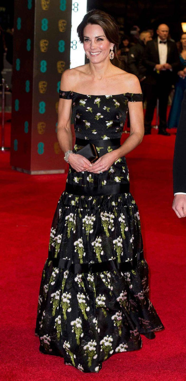<p>For the 2017 BAFTA Awards, Duchess Kate glittered in an Alexander McQueen gown and statement diamond earrings.</p>