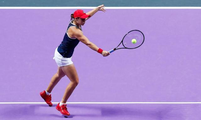 """<span class=""""element-image__caption"""">Ashleigh Barty plays a backhand volley during her 6-4, 6-3 victory over Elina Svitolina in the WTA Finals.</span> <span class=""""element-image__credit"""">Photograph: VCG/VCG via Getty Images</span>"""