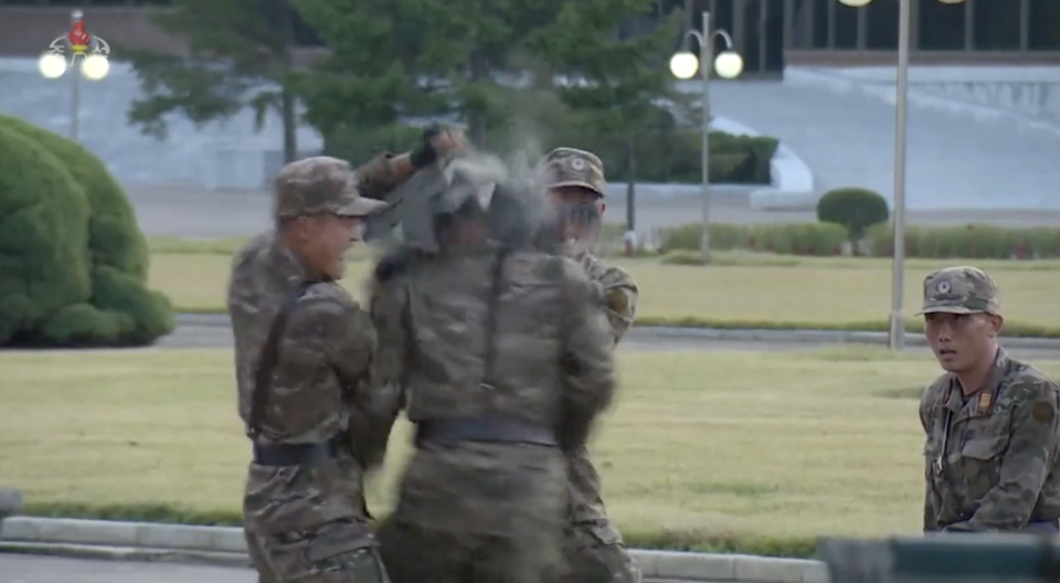 A North Korean soldier runs head first into what appears to be a concrete brick. Source: Twitter