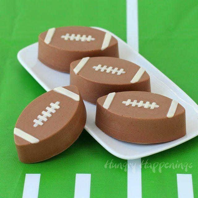 """<p>Four ingredients make up these fudge footballs that use milk and white chocolate chips (as well as peanut butter chips) for a satisfying bite.</p><p><strong>Get the recipe at <a href=""""https://hungryhappenings.com/4-ingredient-reeses-fudge-footballs/"""" rel=""""nofollow noopener"""" target=""""_blank"""" data-ylk=""""slk:Hungry Happenings"""" class=""""link rapid-noclick-resp"""">Hungry Happenings</a>.</strong></p><p><strong><a class=""""link rapid-noclick-resp"""" href=""""https://www.amazon.com/CK-Products-2-Inch-Football-Chocolate/dp/B003QP3HZ6/?tag=syn-yahoo-20&ascsubtag=%5Bartid%7C10050.g.5080%5Bsrc%7Cyahoo-us"""" rel=""""nofollow noopener"""" target=""""_blank"""" data-ylk=""""slk:SHOP FOOTBALL MOLDS"""">SHOP FOOTBALL MOLDS</a><br></strong></p>"""