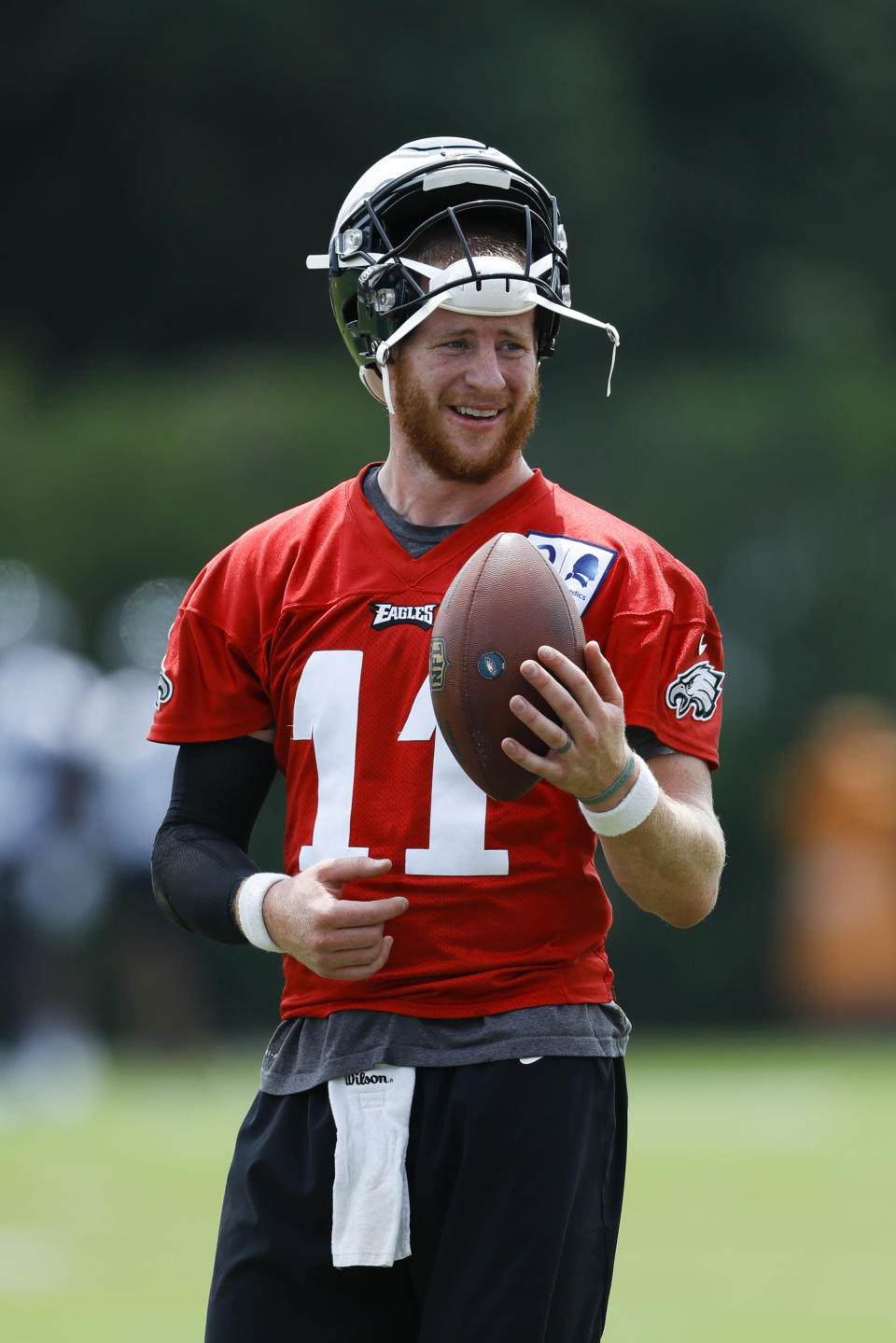 Philadelphia Eagles' Carson Wentz tosses a football during organized team activities at the NFL football team's practice facility, Wednesday, June 5, 2019, in Philadelphia. (AP Photo/Matt Slocum)