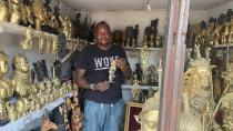 Edosonmwan William, bronze maker is seen with one of his works inside is gallery at Igun street, Benin