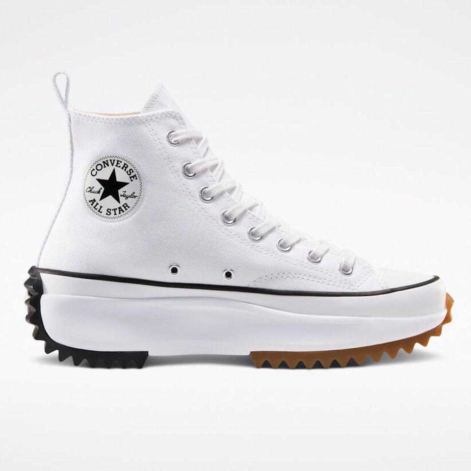 """If you want to make a statement with white sneakers, turn to the experts. Converse's hike shoes put an unexpected twist on your everyday high-tops without compromising comfort or stability. Because they have an exaggerated lug sole and are built more like a boot than a sneaker, you can wear these well into the colder months of the year. $110, Converse. <a href=""""https://www.converse.com/shop/p/run-star-hike-unisex-high-top-shoe/166800MP.html?"""" rel=""""nofollow noopener"""" target=""""_blank"""" data-ylk=""""slk:Get it now!"""" class=""""link rapid-noclick-resp"""">Get it now!</a>"""