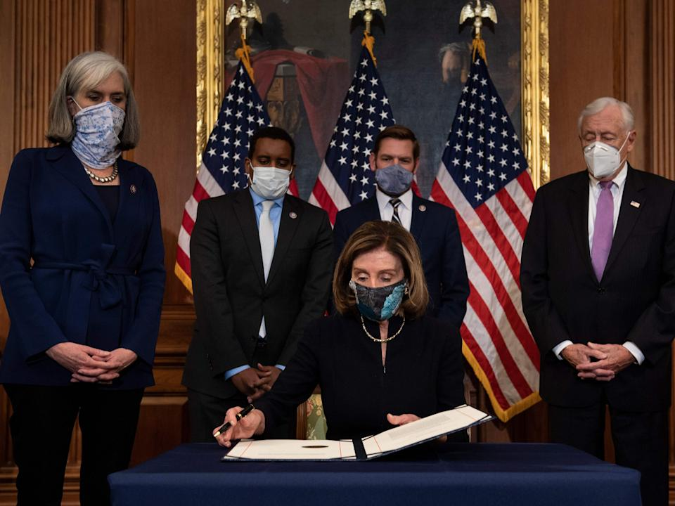 <p>Speaker of the House Nancy Pelosi (D-CA) prepares to sign the article of impeachment during an engrossment ceremony after the US House of Representatives voted to impeach the US President Donald Trump at the US Capitol, January 13, 2021, in Washington, DC.</p> (Getty images)