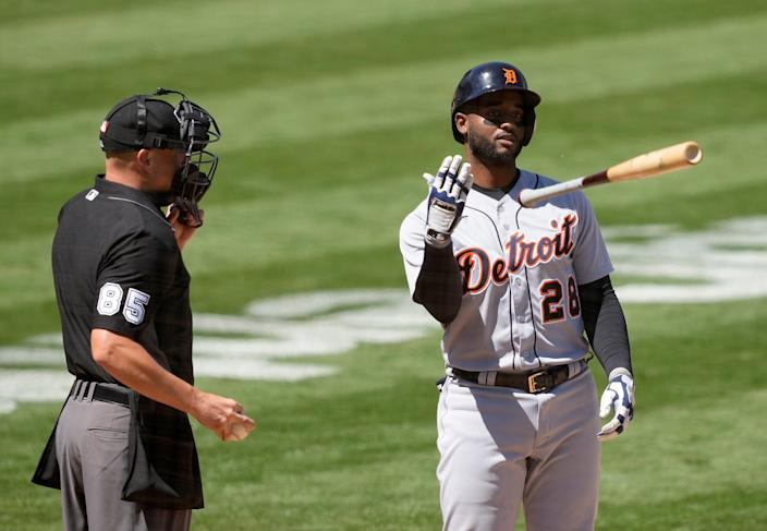 Tigers second baseman Niko Goodrum throws his bat as he is called out by umpire Stu Scheurwater during the fifth inning against the Athletics on Saturday, April 17, 2021, in Oakland, California.