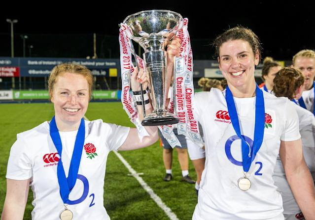 <p>England's La Toya Mason (left) and captain Sarah Hunter hold the Six Nations trophy after winning their Women's 6 Nations match against Ireland to complete the Grand Slam at Donnybrook Stadium, Dublin. </p>