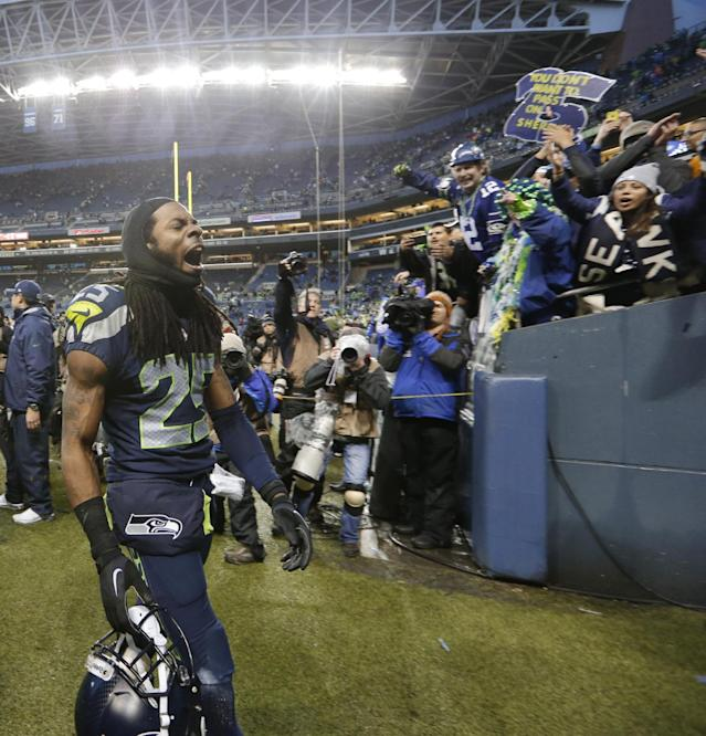 Seattle Seahawks cornerback Richard Sherman celebrates after an NFC divisional playoff NFL football game against the New Orleans Saints in Seattle, Saturday, Jan. 11, 2014. The Seahawks won 23-15. (AP Photo/Elaine Thompson)