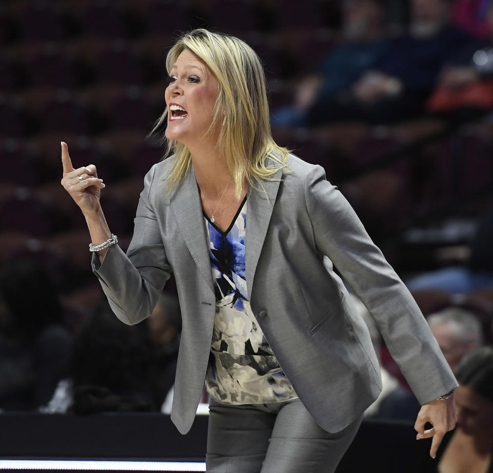 Central Florida head coach Katie Abrahamson-Henderson calls to her team during the first half of an NCAA college basketball game against South Florida in the American Athletic Conference tournament semifinals at Mohegan Sun Arena, Monday, March 5, 2018, in Uncasville, Conn. (AP Photo/Jessica Hill)